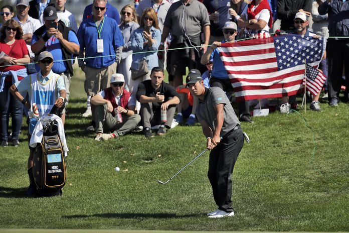 International Team member Hideki Matsuyama hits to the third green during the final round of the Presidents Cup at Liberty National Golf Club in Jersey City, N.J., Sunday, Oct. 1. (AP Photo/Julio Cortez)