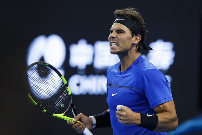 Rafael Nadal of Spain celebrates after winning a set against Lucas Pouille of France during their men's singles match in the China Open tennis tournament at the Diamond Court in Beijing, Tuesday, Oct. 3. (AP Photo/Andy Wong)