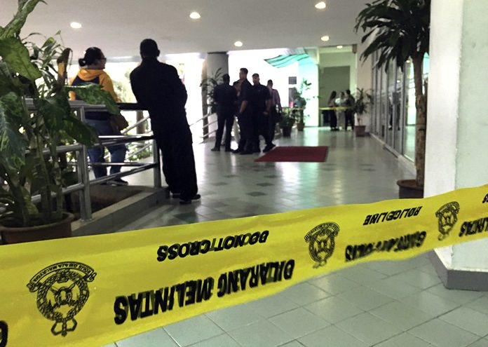 An entrance of the Shah Alam court house is cordoned off as the trial of two women accused of killing North Korean leader's brother is held in Shah Alam, Malaysia, Wednesday, Oct. 4. (AP Photo/Vincent Thian)