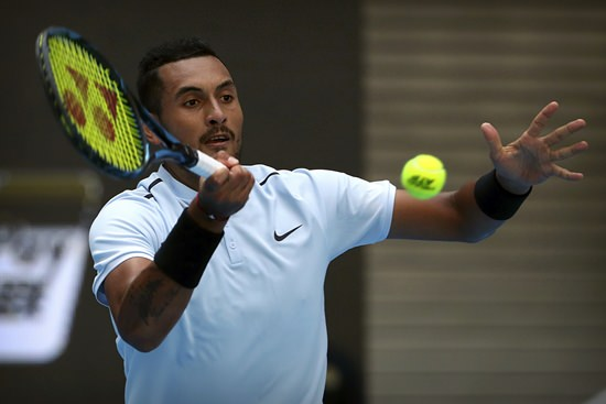 Nick Kyrgios of Australia returns a shot against Mischa Zverev of Germany during their men's singles match in the China Open tennis tournament at the Diamond Court in Beijing, Wednesday, Oct. 4. (AP Photo/Mark Schiefelbein)