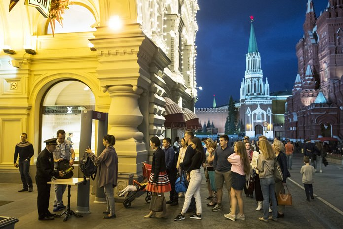 People are checked by security guards before entering GUM, State Shop, at Red square in Moscow, Russia. (AP Photo/Pavel Golovkin, file)