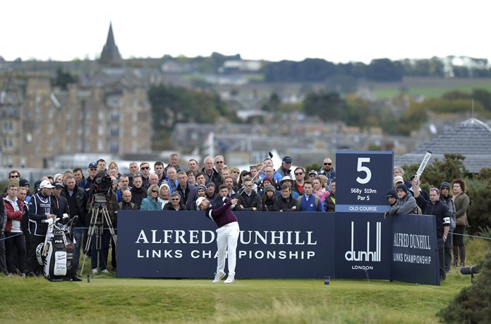 England's Tyrrell Hatton tees off on the fifth hole, during day four of the Dunhill Links Championship at The Old Course at St. Andrews, in Fife, Scotland, Sunday Oct. 8. (Mark Runnacles/PA via AP)