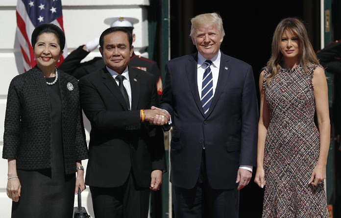 President Donald Trump and first lady Melania Trump greet Thailand's Prime Minister Prayuth Chan-ocha, and his wife Naraporn Chan-ocha, Monday, Oct. 2, 2017, as they arrive at the White House in Washington. (AP Photo/Carolyn Kaster)