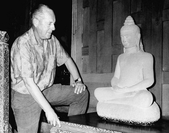 American businessman Jim Thompson views a Buddha statue in Bangkok in this November 1966 file photo. (AP Photo)