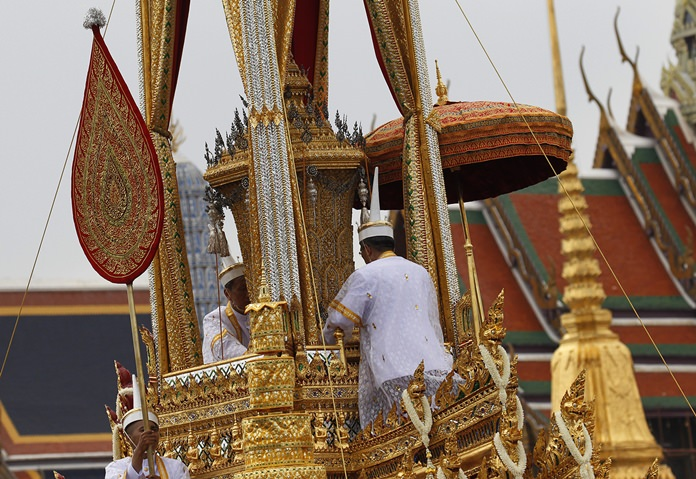 The symbolic urn is transported during the funeral procession of late Thai King Bhumibol Adulyadej in Bangkok, Thursday, Oct. 26, 2017. Bhumibol's death at age 88 after a reign of seven decades sparked a national outpouring of grief and a year of mourning, culminating in an elaborate funeral and cremation ceremony last week.(AP Photo/Sakchai Lalit)