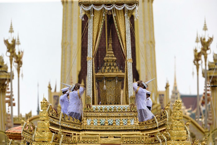 Bearers of the Royal Urn pay their respects during the funeral procession and royal cremation ceremony of late King Bhumibol Adulyadej. (AP Photo/Kittinun Rodsupan)