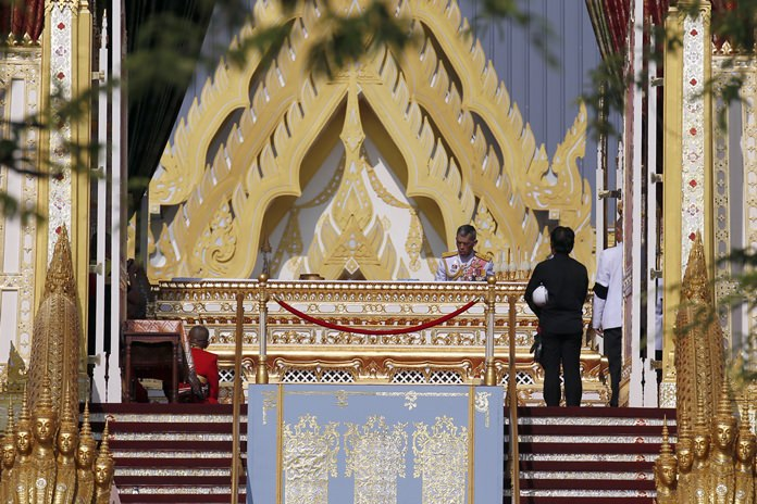 HM King Maha Vajiralongkorn (center) participates in religious rituals to move his father, late King Bhumibol Adulyadej's ashes following the royal cremation ceremony. (AP Photo/ Sakchai Lalit)