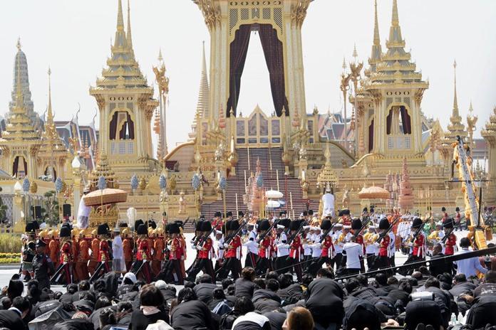 Royal palace officials move royal relics of late King Bhumibol Adulyadej during a royal procession in Bangkok. (AP Photo/Kittinun Rodsupan)