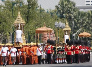 Participants march in religious rituals to move the ashes of the late King Bhumibol Adulyadej, Friday, Oct. 27, 2017. (AP Photo/Sakchai Lalit)