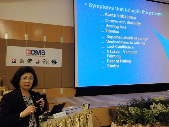 Dr. Sujittra Prasansuk, director of Bangkok Hospital Pattaya's Ear, Nose & Throat Center, tells doctors and nurses at the Oct. 16 workshop how people need to moderate use of technology to preserve their hearing into later years.