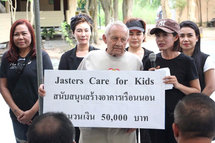 While thanking the donors Noi (right, with microphone), President of Pattaya YWCA and initiator of the project, made special mention of the Jesters donation.
