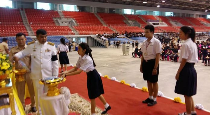 More than 15,000 Pattaya residents received mementoes of their once-in-a-lifetime experience helping during the area's mirror royal cremation ceremony in the form of uniforms and identification cards.