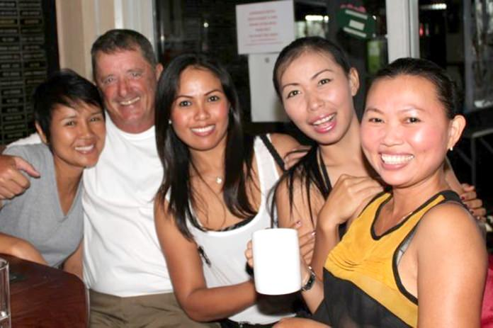 Don Lehmer (2nd left) celebrates with the girls at the TPL.