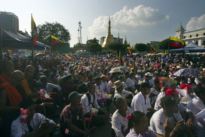 Participants attend a ceremony supporting the country's military and government servants Sunday, Oct. 29, 2017, in Yangon, Myanmar. (AP Photo/Thein Zaw)