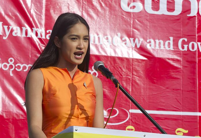 Shwe Eain Si, dethroned Miss Grand Myanmar 2017, speaks during a ceremony supporting the country's military and government servants Sunday, Oct. 29, 2017, in Yangon, Myanmar. (AP Photo/Thein Zaw)