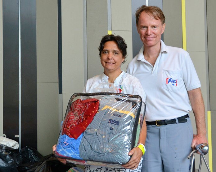 Margaret Grainger and member Ren Lexander show some of the donations brought by PCEC members and guests for the use and benefit of the Hand to Hand Foundation.