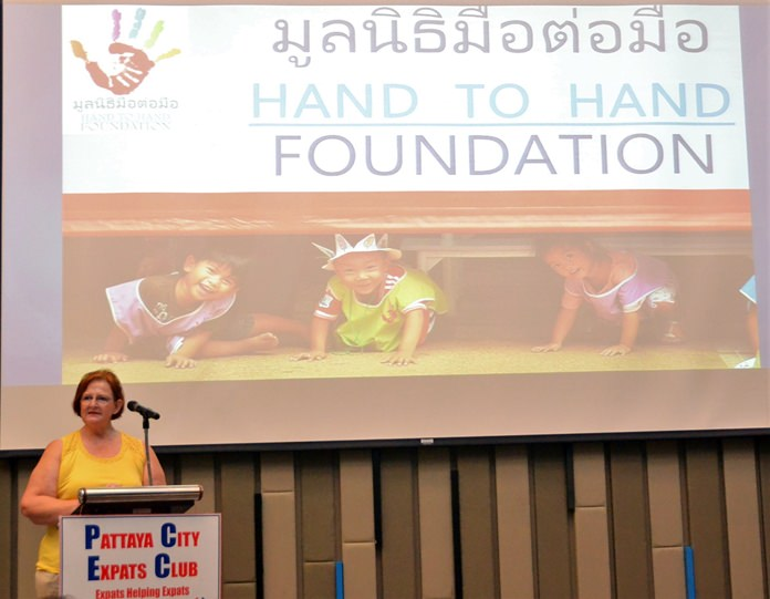 MC Ann Ensell introduces Margaret Grainger from Hand to Hand Foundation to the Pattaya City Expats Club.
