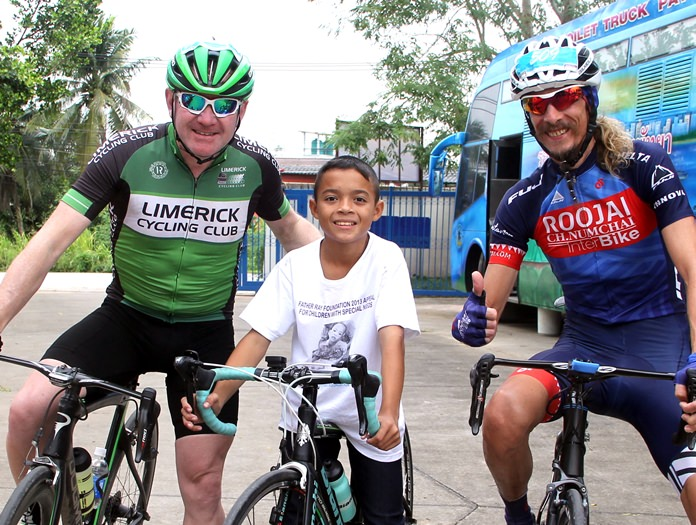 Expats Adrian and Alan pose with one of the boys from the Fr. Ray Foundation.