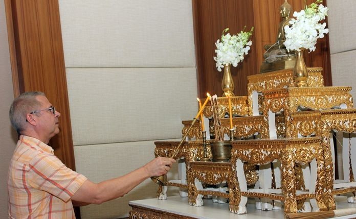 General Manager Andre Brulhart lights candles and incense during religious ceremonies marking the hotel's 8th anniversary.