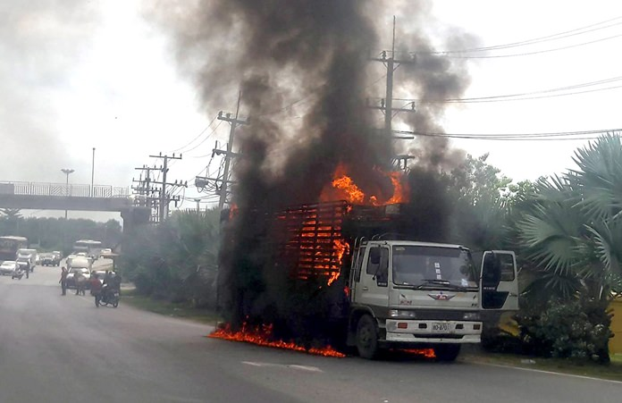 A million baht in furniture went up in flames and traffic on Sukhumvit Road in front of Najomtien Temple was backed up for over an hour when this six-wheeled moving truck caught fire in Sattahip.