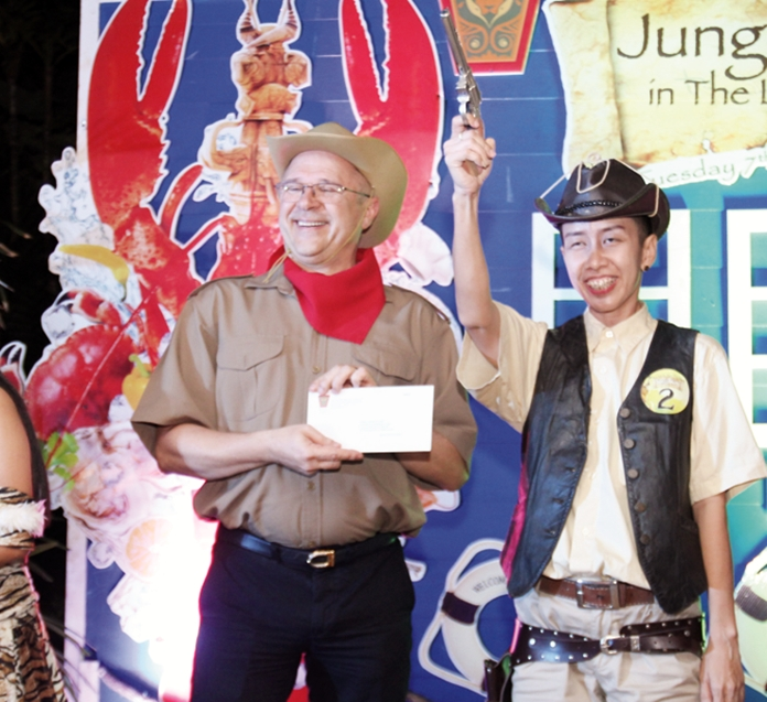 Andre Bruhlhart presents the best male costume prize to Wanida Lopisanchai.
