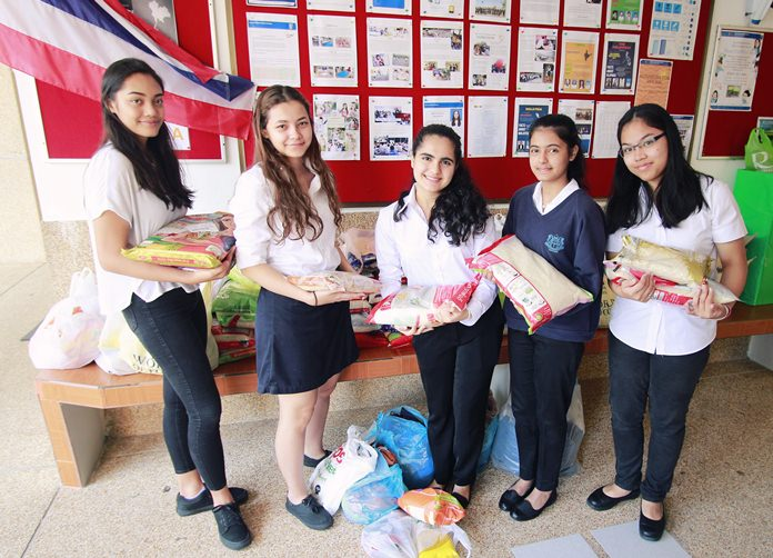 IB students from GIS helped collect dozens of bags of rice for Hand to Hand.