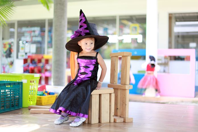 A wonderful-looking witch has fun at Halloween.