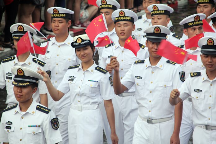 The Chinese Navy is undeterred by the rain.