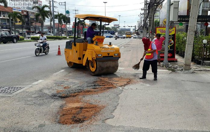 "Pattaya's ""pothole patrol"" was back in action Nov. 15, patching the intersection of Thepprasit and Sukhumvit Roads, ground zero for storm flooding."