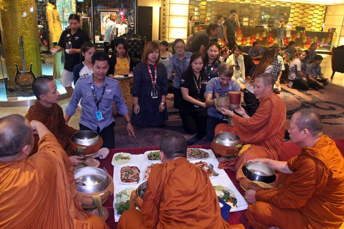 Monks receive offerings of food and necessities from the staff.
