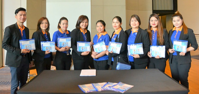 "Bangkok Bank staff from several of their Pattaya Branches pose with copies of the Bank's publication ""Welcome to Bangkok Bank"", a guide for foreigners which is available at their branches."