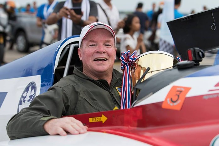 Tim Cone of the USA holds the trophy in his aircraft cockpit after winning the gold class at the Air Race 1 World Cup Thailand event held at U-Tapao Air Base from November 17-19.