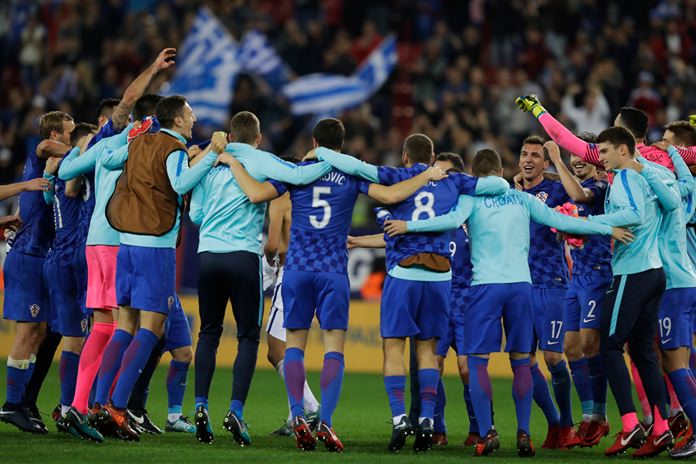 Croatia's players celebrate their team's qualification to the World Cup after the qualifying play-off second leg match against Greece at Georgios Karaiskakis stadium, in Piraeus port, near Athens, Sunday Nov. 12. The match ended 0-0.(AP Photo/Thanassis Stavrakis)