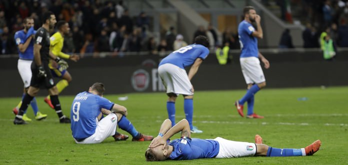 Italian players react to their team's elimination in the World Cup qualifying play-off second leg match against Sweden at the San Siro stadium in Milan, Italy, Monday, Nov. 13. (AP Photo/Luca Bruno)