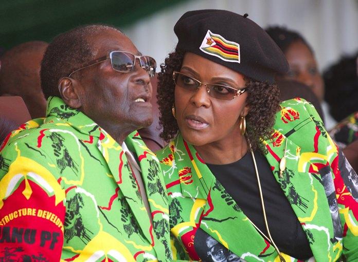 Zimbabwean President Robert Mugabe, left, and his wife Grace are shown in this June, 2, 2017 file photo. (AP Photo/Tsvangirayi Mukwazhi)