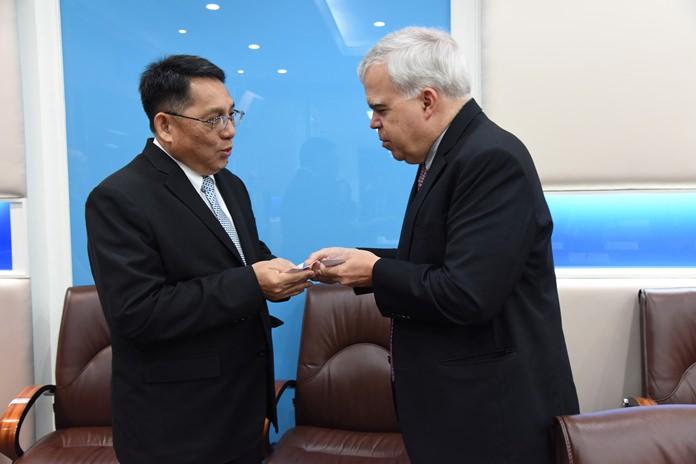 Permanent Secretary for Labor, Jarin Chakkaphark, left, greets Peter Haymond, Deputy Chief of Mission at the United States Embassy in Bangkok, Wednesday, Nov. 15.
