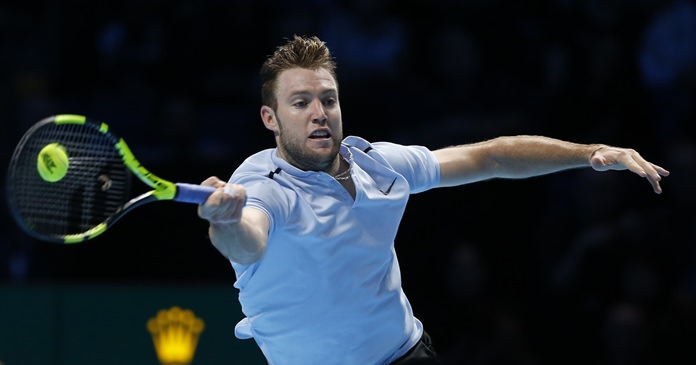 Jack Sock of the United States plays a return to Alexander Zverev of Germany during their men's singles tennis match at the ATP World Finals at the O2 Arena in London, Thursday, Nov. 16. (AP Photo/Alastair Grant)