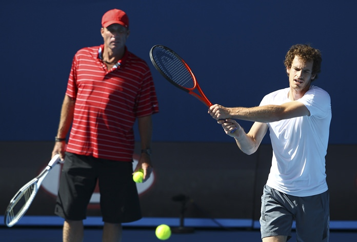 In this Jan. 26, 2012 file photo, Britain's Andy Murray, right, is watched by his coach Ivan Lendl as he trains in Rod Laver Arena in Melbourne, Australia. (AP Photo/Rick Rycroft)
