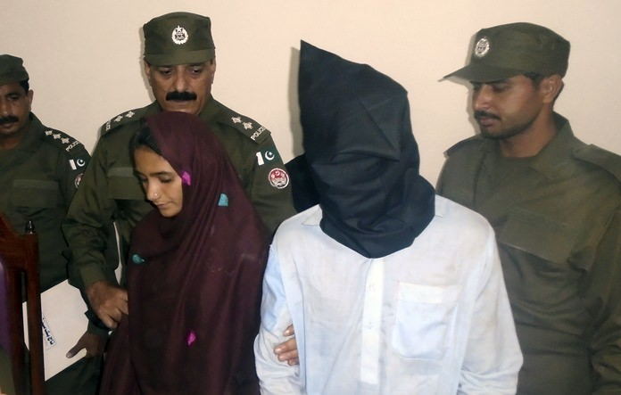 In this Monday, Oct. 30, 2017 photo, 21-year-old Aasia Bibi and her boyfriend, Shahid Lashari, are presented to journalists, at a police station in Muzaffargarh in Pakistan. (AP Photo/Iram Asim)