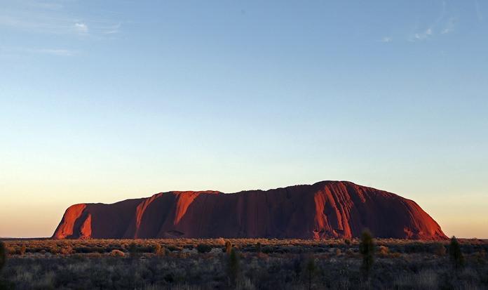 The sun rises over Uluru, central Australia in this April, 22, 2014, file photo. (AP Photo/Rob Griffith)