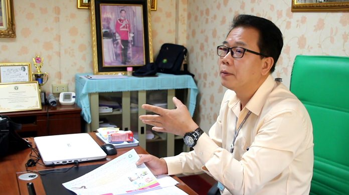 Sompol Jithiruengkiat of the Banglamung Health Department, warns residents to properly cook freshwater shellfish and snails to prevent infection from the potentially fatal Guinea worm.