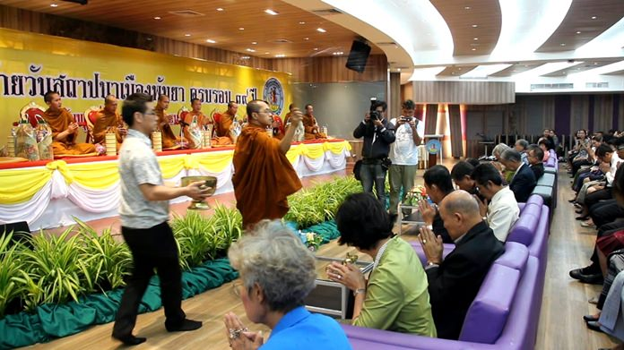 City councilors and civil servants gather to make merit and celebrate the 39th year anniversary of Pattaya City Hall.