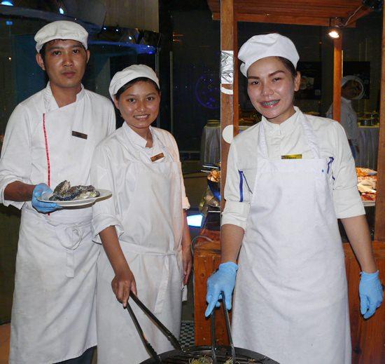 Three seafood BBQ chefs.