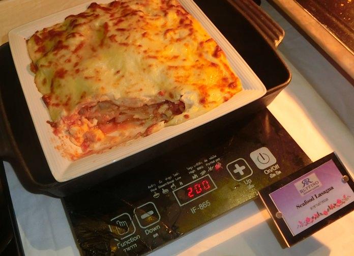 A seafood lasagna staying warm.
