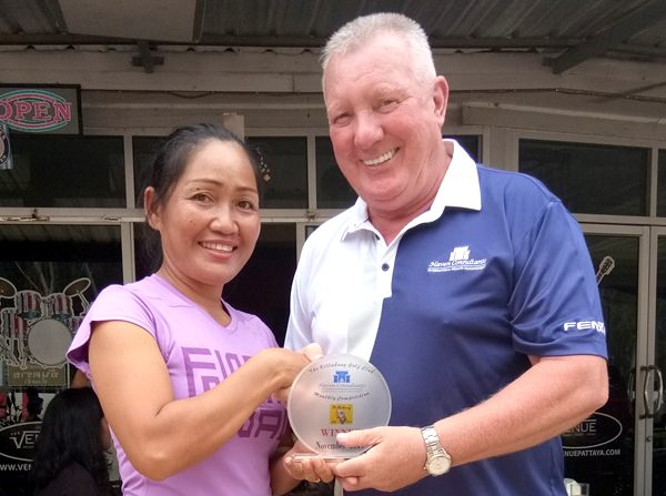 Som receives her medal from Brian Chapman.