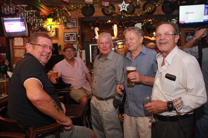 Friends gather around to wish Billy Wilson a Happy Birthday.