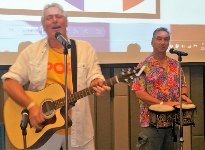 Pattaya Musician Barry Upton on guitar accompanied by Paul Rosenberg on bongos, entertain their PCEC audience with many songs that had everyone tapping their toes.