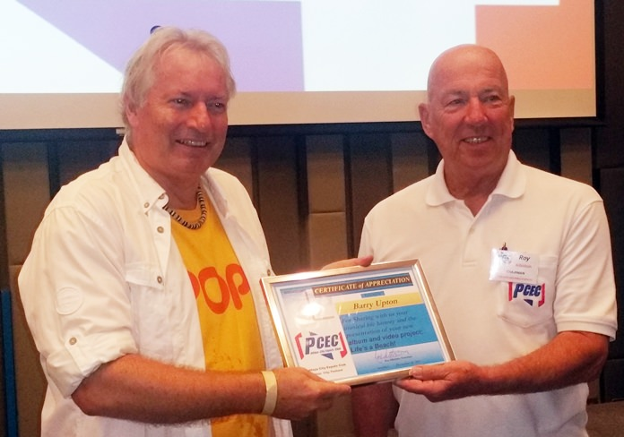 MC Roy Albiston presents Barry Upton with the PCEC's Certificate of Appreciation for his interesting recount of his music career and entertaining songs.