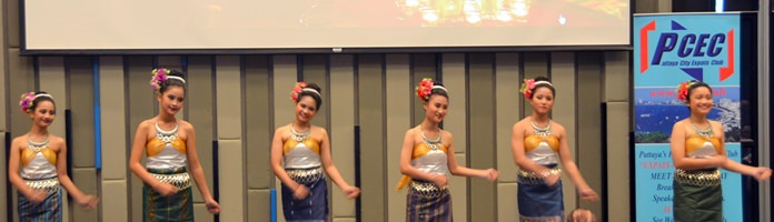 These six beautiful young ladies from the Pattaya Orphanage dressed in traditional costume began the PCEC's Christmas program by performing a graceful traditional Thai dance for the audience.