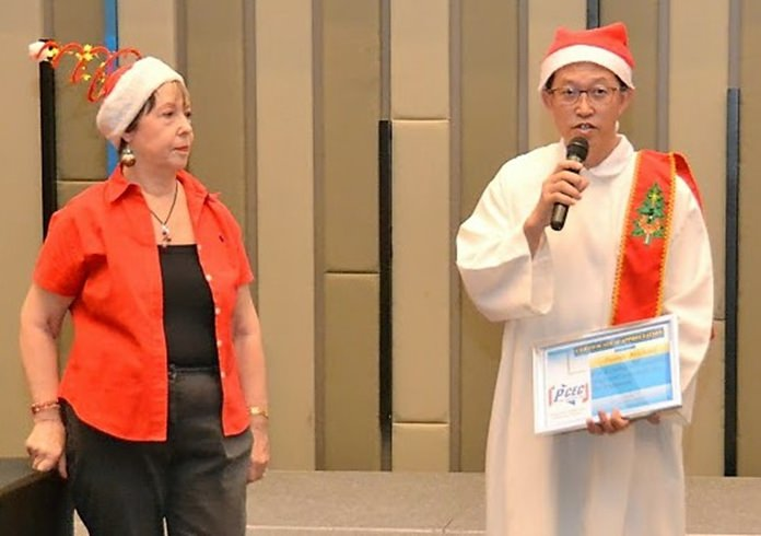 After Member Judith Edmonds presented Somkiat (Paul) from the Orphanage with the PCEC' Certificate of Appreciation to the Orphanage, he thanks everyone for their generosity. He then extends an invitation to all to attend the Orphanage's annual Christmas Party on 25th December.